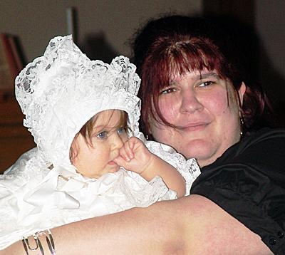Helena hugs her daughter MaryAnna during the baby' christening in early March.